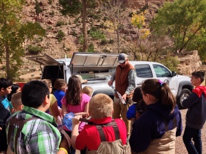 Scott Murray shows students how the SWQB measures water quality.