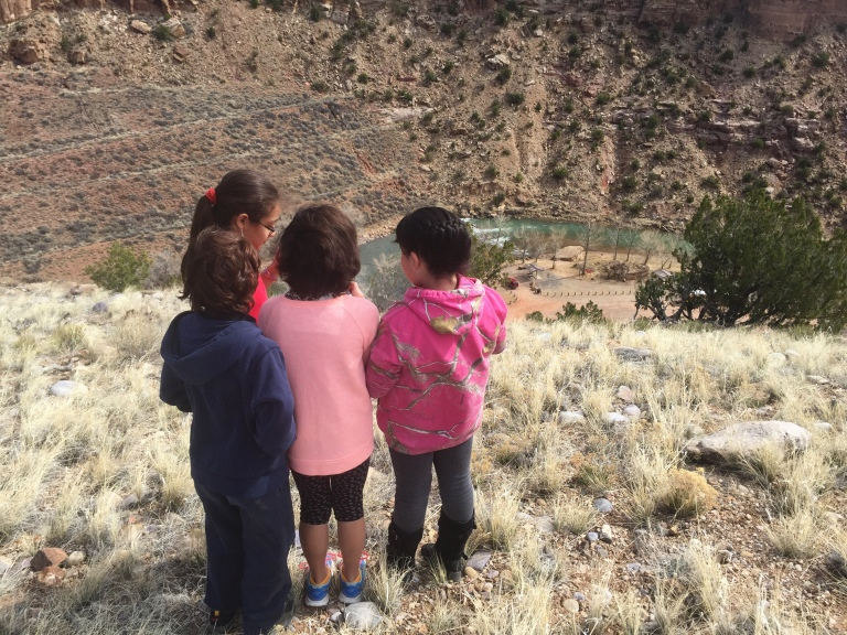 A group of students outlines the landforms across the canyon.