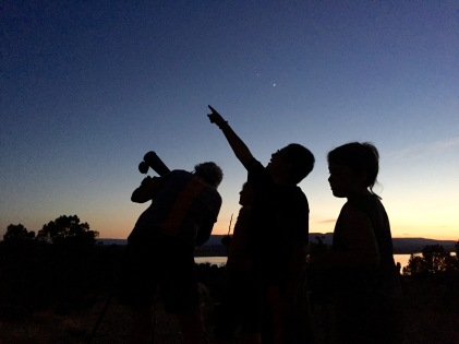 Campers watching the night sky.